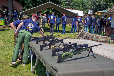 Vrsac, hill, Serbia, June 27, 2020. A group of military veterans of the 63rd Parachute Brigade is celebrating their day. Weapons and sniper rifles were displayed on the table.
