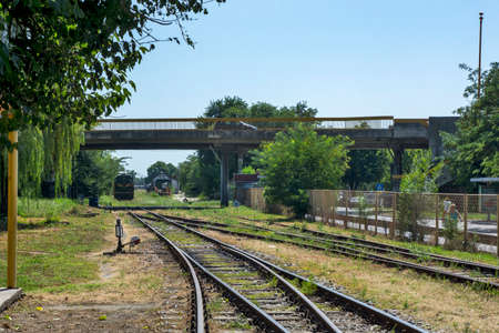 Zrenjanin, Serbia, August 31, 2020. Diesel locomotive 661 - 243, which mainly hauls freight trains, goes by train to the neighboring station.