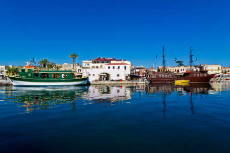 Ships at the old Venetian harbour, city of Rhetymno, Crete photo