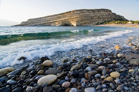 Scenic look of Matala beach and it s famous rock with a lot of caves photo