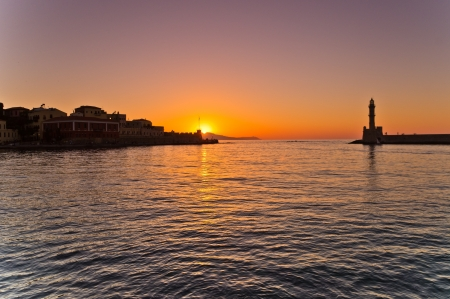 Sunset at the entrance of the old harbour of Hania, Crete Stock Photo