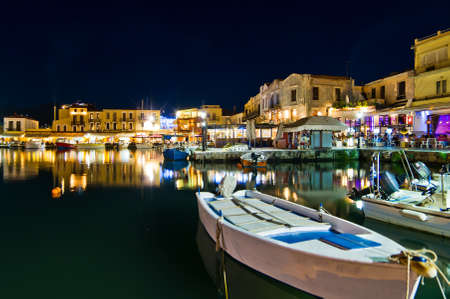 Summer night shot of the old Venetian harbour at the port of Rhetymno, Crete
