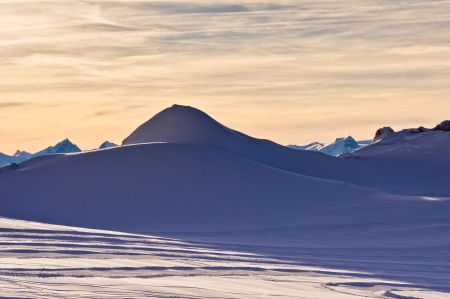 Sunset on a glacier - late afternoon of a very short winter day at the Alps photo