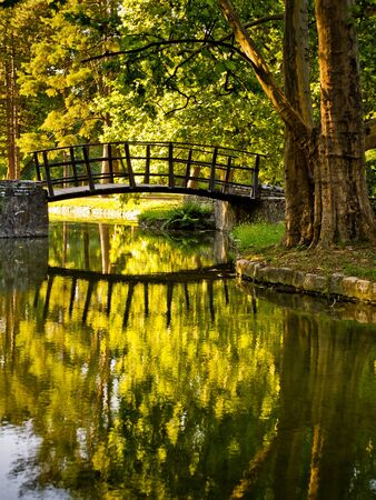 Lovely water reflection of the wooden bridge in the Topcider park  Stock Photo