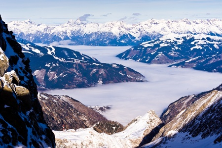 View of the Zel am See foggy valley from the top of Kaprun glacier Stock Photo - 18752298