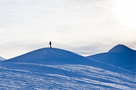 Lonely skier trying to reach the top of Kaprun glacier Stock Photo - 18752215