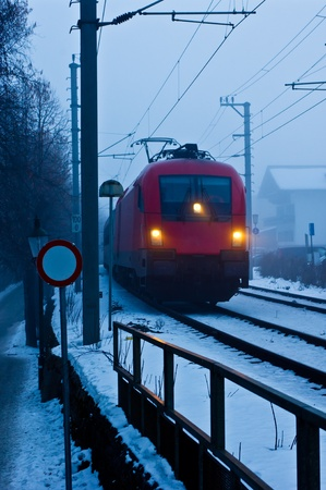 Train in a fog near Zell am See in Austria
