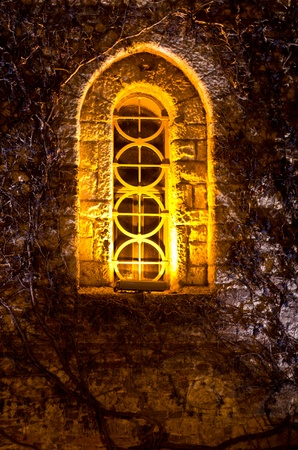 Church window at night, Kalemegdan fotress, Belgrade, Serbia photo
