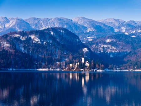 Sunny winter morning on a lake Bled, Slovenian Alps Stock Photo - 19046220