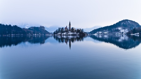 symetry: Perfect symetry of a lake and church on a small island, Bled, Slovenia Stock Photo