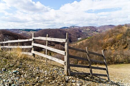 Wooden fence on a hill, Valjevo mountains, Serbia photo