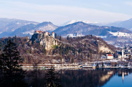 Sunny winter morning on a lake bled, a view of Bled castle with its surroundings Stock Photo - 19212966