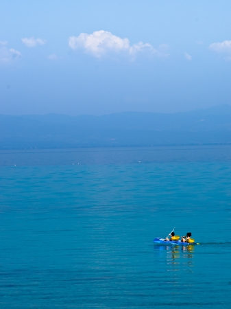 Rowing at the sea in a funny yellow rubber boat photo