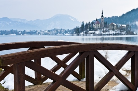 Little wooden bridge by the lake Bled in Slovenian Alps photo