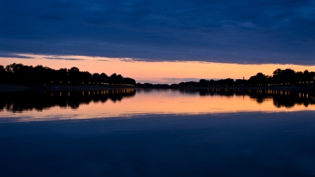 Evening clouds and its reflection in a lake Ada,  Belgrade, Serbia photo