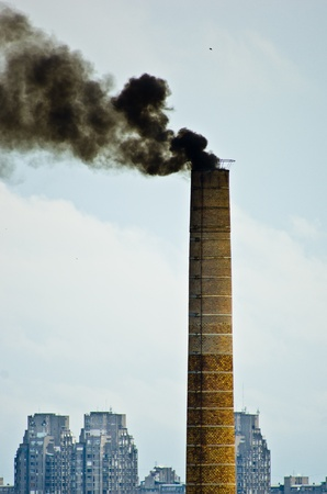 Free cancer for everyone - big old industrial chimney without proper filter is dangerous for everyone s health photo