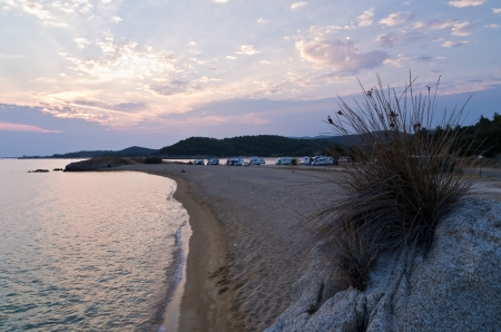 Sunset at campers favorite cape for summertime vacations in Macedonia Greece