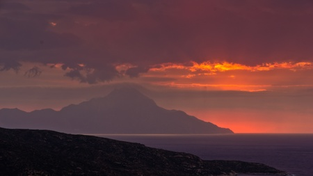 Stormy sky and sunrise at holy mountain Athos in Greece photo