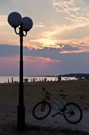 sithonia: Lantern and bicycle by the beach at sunset, Sithonia, Greece Stock Photo