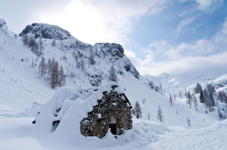 Mountain hut - shelter for mountaneers from the snow storm in winter,  mountain Vogel,  slovenian Alps photo