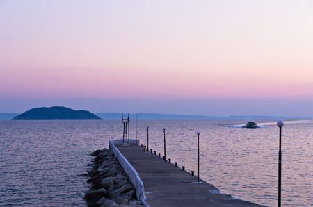 sithonia: Pier and turtle island in a background, near the city of Neos Marmaros, Sithonia, Greece