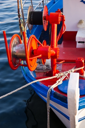 Fishing boat, detail with red colorful machinery, Porto Koufo, Greece photo