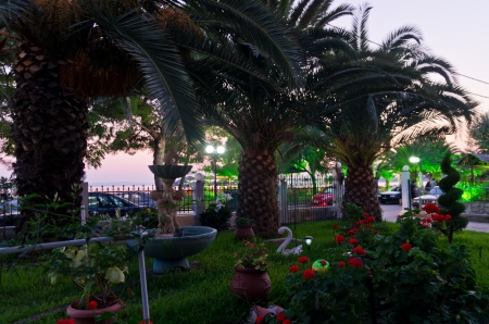 sithonia: Twilight by the sea with palms and beutifull garden if front, Sithonia, Greece