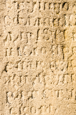 Ancient cyrilic script in a stone, at old Belgrade fortress, Serbia