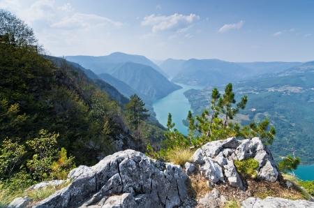 Viewpoint Banjska rock at Tara mountain looking down to Canyon of Drina river, west Serbia photo