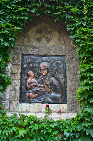 Icon of a Virgin Mary with Christ on a church wall at Kalemegdan fortress, Belgrade, Serbia photo