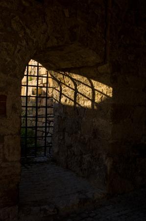 arrestment: Sun light through the dungeon bars at Kalemegdan fortress, Belgrade, Serbia