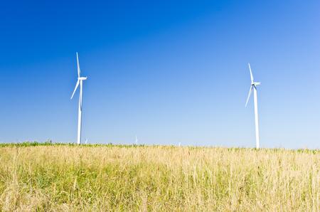 Modern windmills at flat land of Banat region, west Romania Stock Photo - 23011461