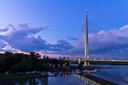 Cable bridge at twilight over Sava river near Ada island, Belgrade, Serbia Stock Photo