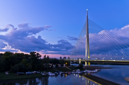 Cable bridge at twilight over Sava river near Ada island, Belgrade, Serbia Banco de Imagens
