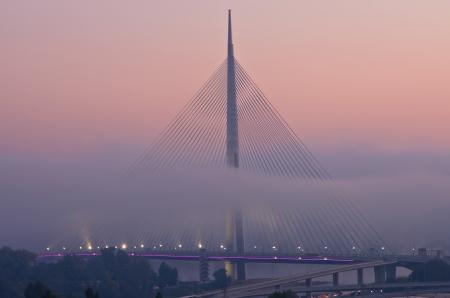 Cable bridge in fog at morning, Belgrade, Serbia photo