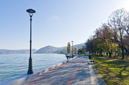 Danube river wide like a sea, promenade at city of Golubac, Serbia photo