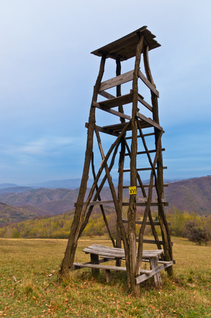 watchtower: Hunting watchtower on a mountain meadow at sunset, east Serbia Stock Photo