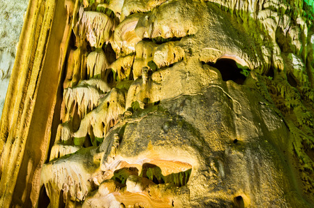 drop ceiling: Detail of lluminated cave wall with a lot of amazing natural decorations, Homolje mountains, east Serbia