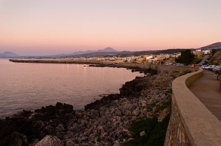 fortezza: Promenade along the coast and below Fortezza fortress at twilight, city of Rethymno, Crete, Greece Stock Photo