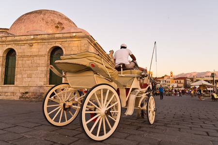 Horse carriage in Chania harbor at sunset, Crete, Greece