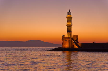 Scenic view of the entrance to Chania harbor with lighthouse at sunset, Crete, Greece photo