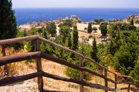 Stairway with a wooden fence to the coast of Lybian sea, island of Crete, Greece photo