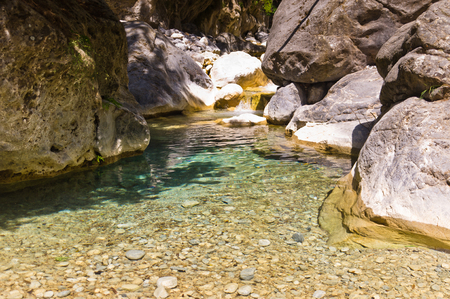 Mountain creek through the rocky soil of Samaria gorge, island of Crete, Greece photo
