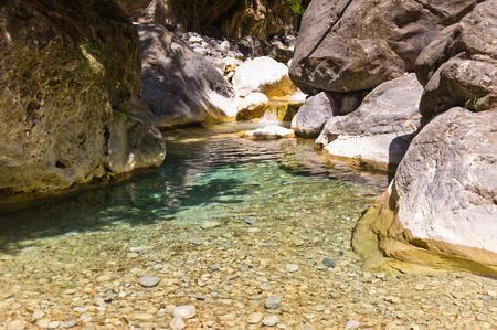 Mountain creek through the rocky soil of Samaria gorge, island of Crete, Greece photo