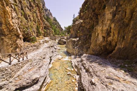Mountain creek through the rocky soil of Samaria gorge, island of Crete, Greece