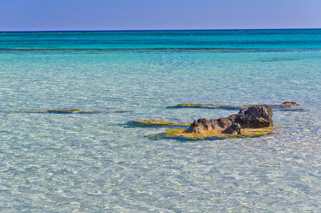 Amazing beauty of crystal clear waters at Elafonisi beach, island of Crete, Greece photo