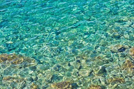 turqoise: Rocky sea floor visible thru crystal clear turqoise water of Aegean sea in Greece