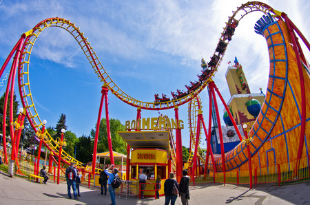 Super wide view of a colorful roller coaster in Prater amusement park at Vienna, Austria Editorial