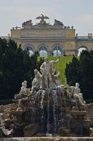 gloriette: Neptune fountain in front of Schenbrunn park and palace in Vienna, Austria