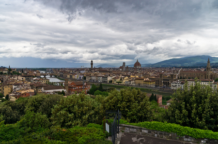 Panorama of Florence with dramatic sky before a storm, Tuscany, Italy photo